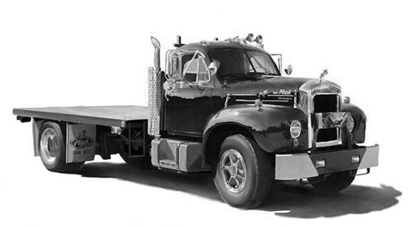 Flatbead truck on field of white - needs DOT inspection