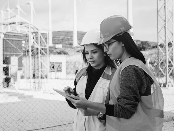 women_performing_equipment_safety_inspection_checklist_for_OSHA_ASME_standards - black and white