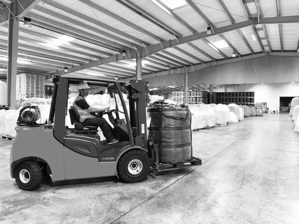 Personnel forklift in warehouse - black and white photo