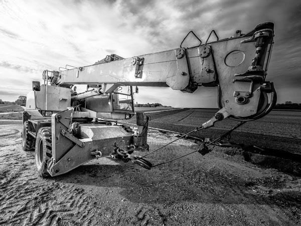 Artistic black and white photo of mobile rough terrain crane