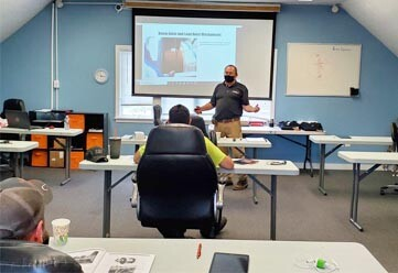 Masked and socially distanced in person classroom training for crane safety