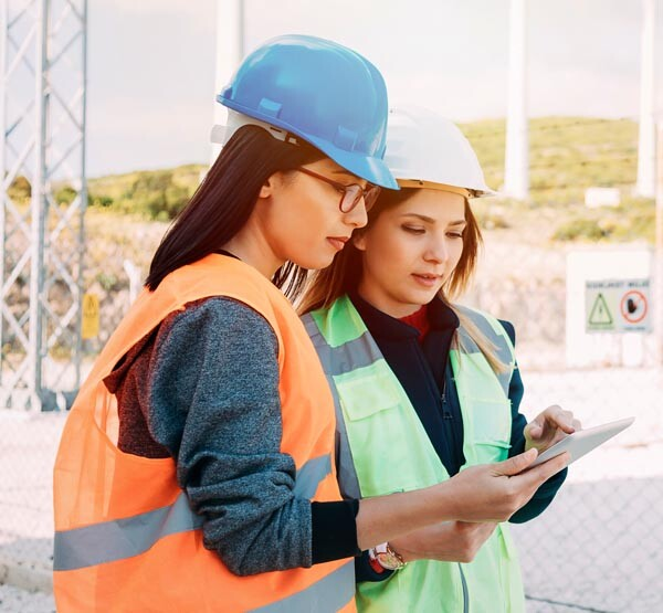 women_performing_equipment_safety_inspection_checklist_for_OSHA_ASME_standards
