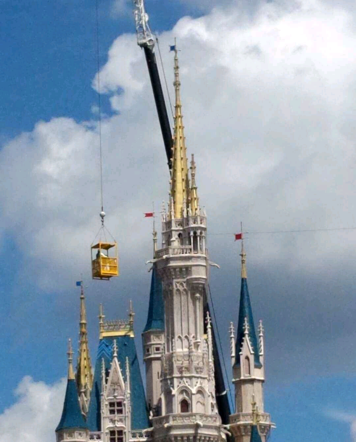 The magic of Disney is multiplied by the crane rising over the castle