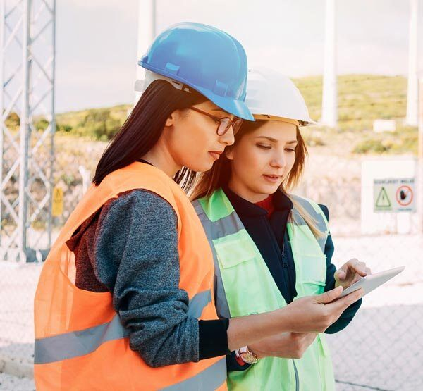 women doing inspections on a tablet